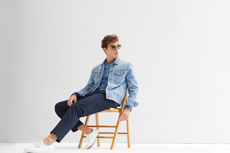 Casually chic, Alexandre Cunha models a Todd Snyder Japanese stretch selvedge denim jacket $288 in stone wash with a + Champion tie-dye sweatshirt $148 in blue grotto and navy pants.