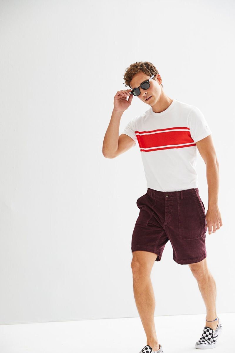 """Alexandre Cunha sports a Todd Snyder + Champion chest stripe tee $70 with 9"""" stretch Italian corduroy camp shorts $168 in burgundy."""