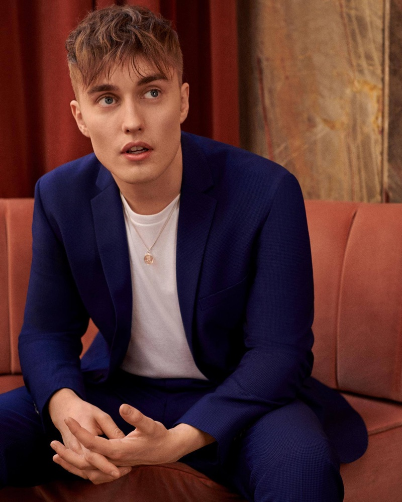 Sam Fender dons a blue suit and white pullover for Topman's latest campaign.