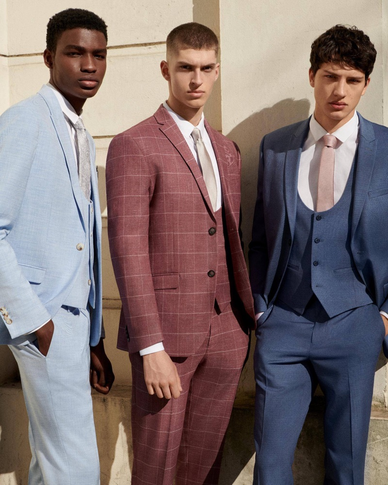 Models Michael Chima, Azim Osmani, and Romain Hamdous star in Topman's suit campaign.