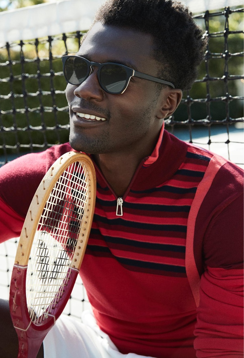 Ready for a game of badminton, Remi Alade-Chester sports Warby Parker's Topper sunglasses.