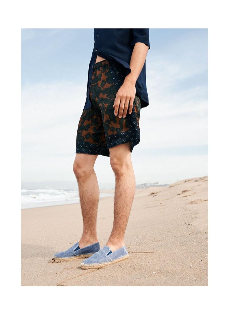 Embracing summer style, Lucas Bin sports light blue espadrilles from YOOX.