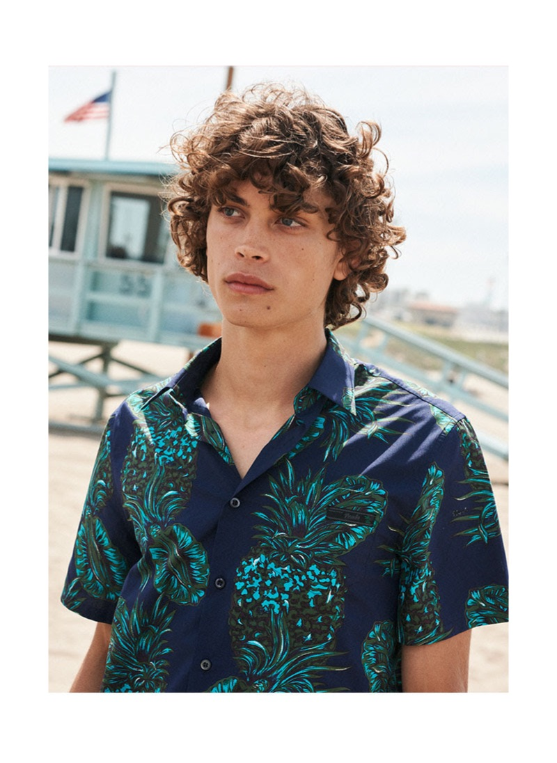 Making a case for leisure, Lucas Bin wears a patterned shirt $540 by Prada.