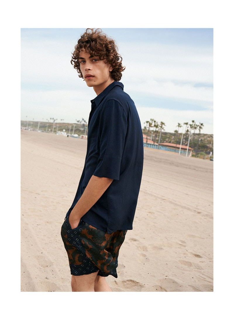 Connecting with YOOX, Lucas Bin hits the beach in summer style.