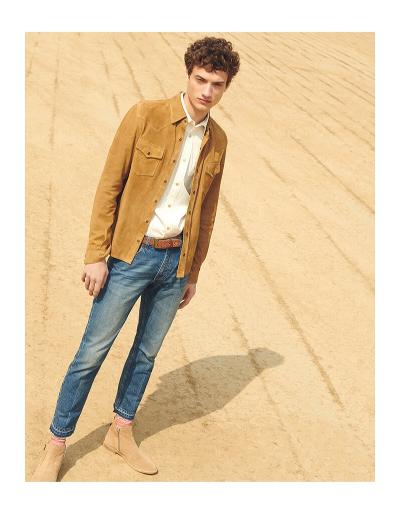 Serge Rigvava embraces western style in a suede overshirt with a Calvin Klein shirt, Gucci jeans, and suede ankle boots.