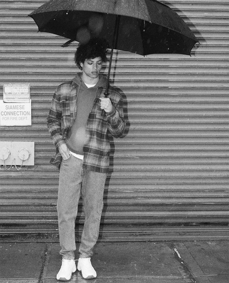 Enduring a rainy day, Danny McFadden wears a look from Zara.