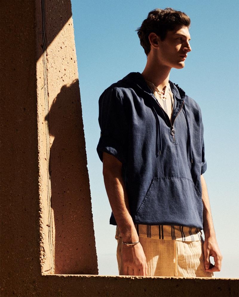 Venturing outdoors, Aaron Shandel sports linen fashions from Zara.