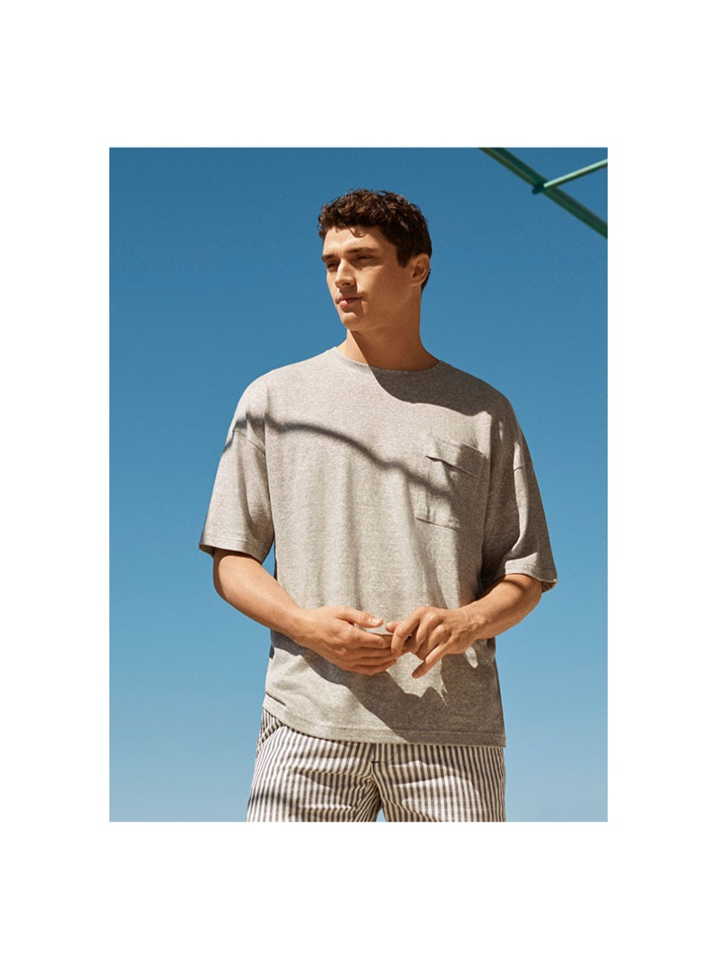 Going casual, Matthew Holt models a 8 by YOOX t-shirt $39 and striped Bermuda shorts $74.
