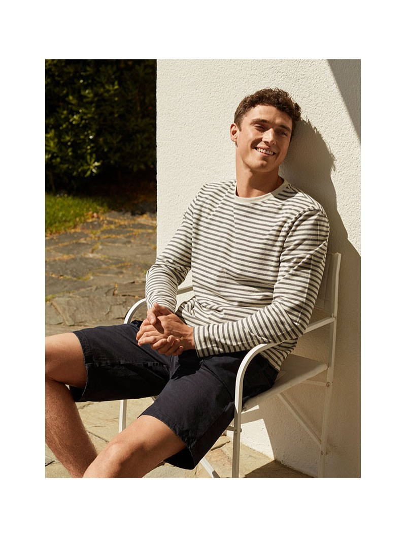 All smiles, British model Matthew Holt dons a striped pullover and denim shorts from 8 by YOOX.