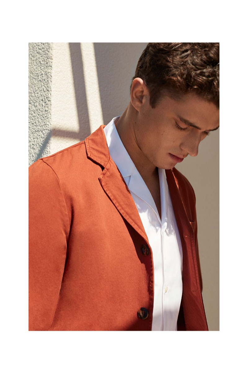 Modeling 8 by YOOX, Matthew Holt wears a white shirt $95 and rust colored blazer $79.