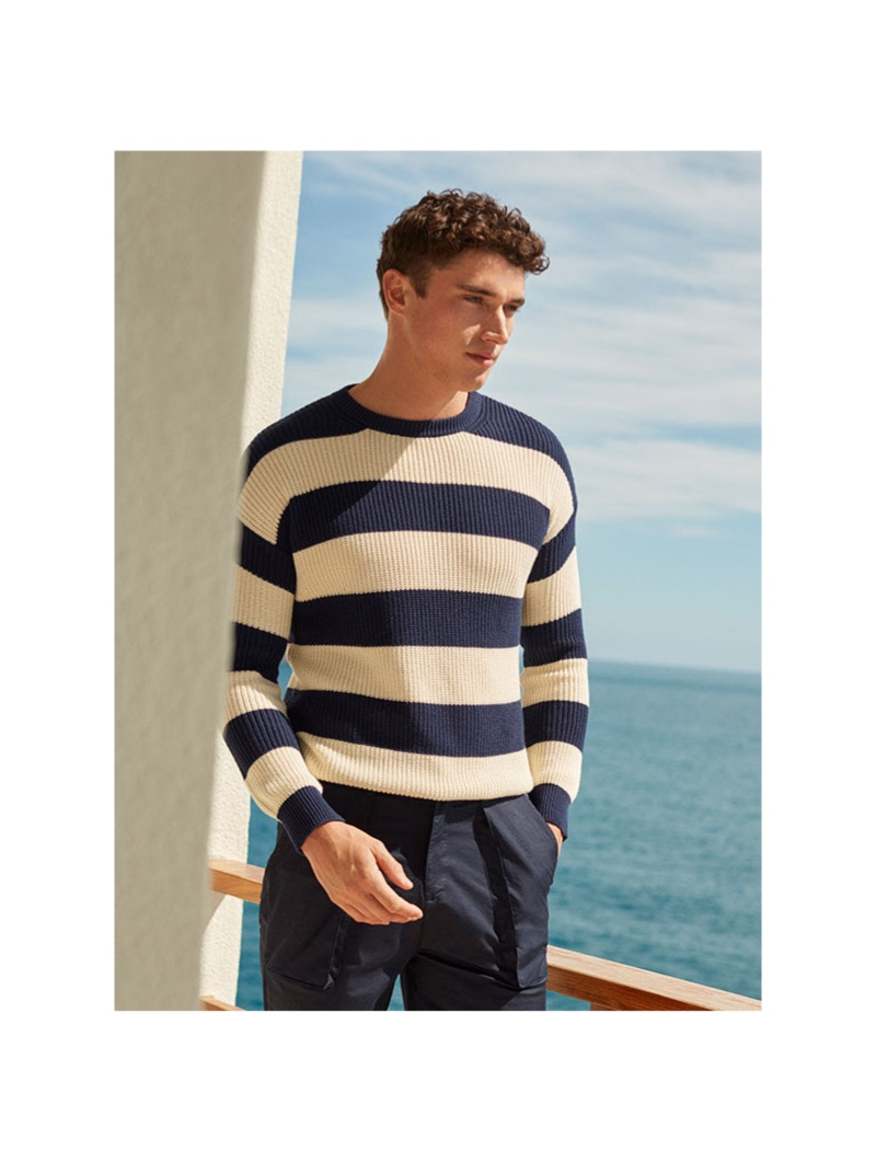 A summer vision, Matthew Holt dons a 8 by YOOX striped sweater $89 and Bermuda shorts $59.