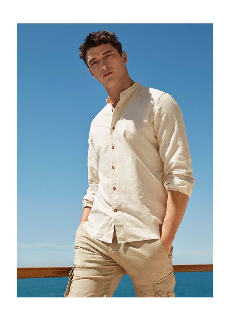 Matthew Holt wears a 8 by YOOX shirt $79 and cargo pants $79.