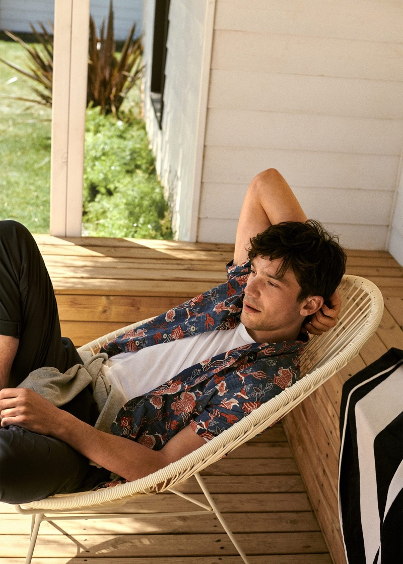 Relaxing, Alexis Petit models one of Mango's summer print shirts.