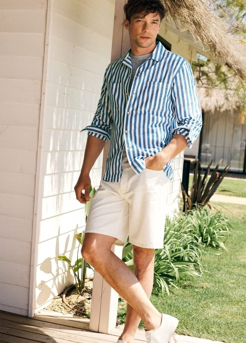 Front and center, Alexis Petit wears a striped shirt with shorts by Mango.