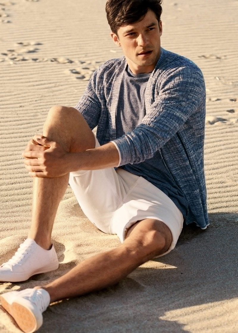 Taking to the beach, Alexis Petit rocks a ribbed cardigan with a tee and shorts from Mango.