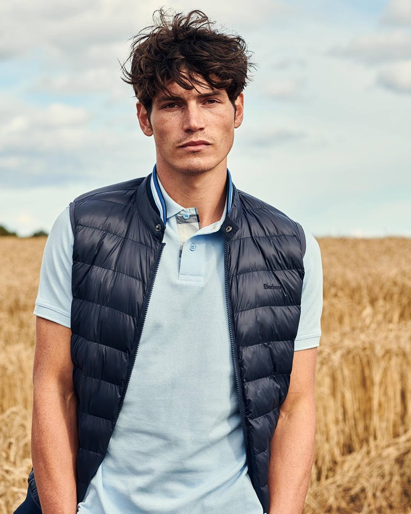 British model Sam Way dons a quilted vest and shirt from the fall-winter 2019 Barbour Tartan collection.