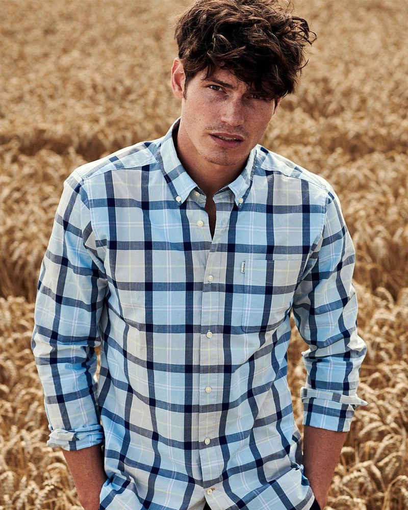 Venturing outdoors, Sam Way wears a checked shirt from the Barbour Tartan fall-winter 2019 collection.