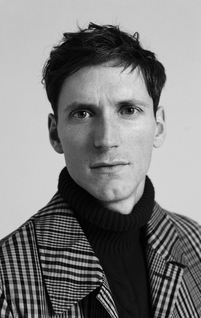 Ready for his close-up, Bastiaan Ninaber dons an Oliver Spencer sweater and Burberry overcoat.