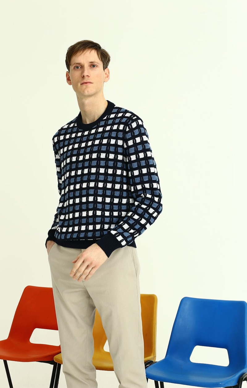 Model Bastiaan Ninaber sports a Marni textured knit sweater with Paul Smith chinos.