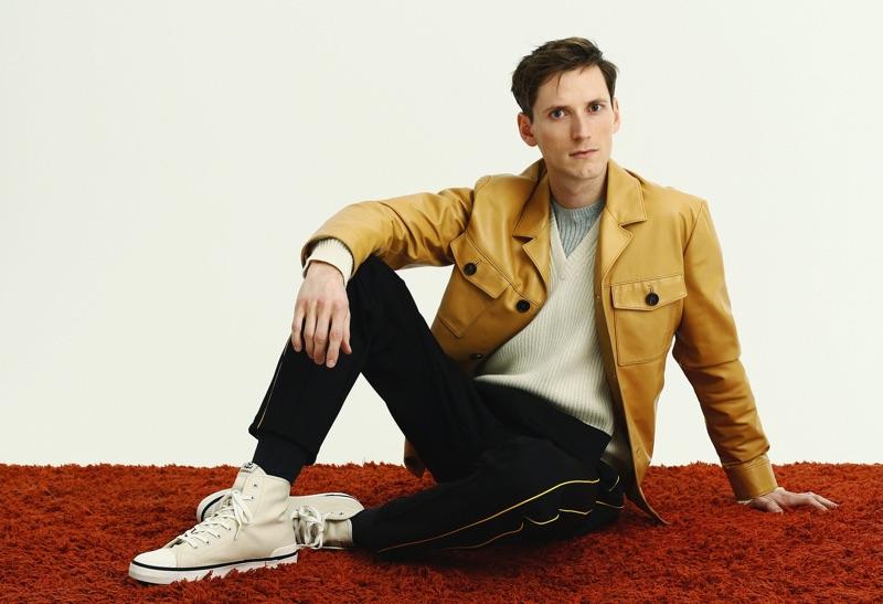 Dressed to impress, Bastiaan Ninaber rocks a Prada leather jacket, knit cashmere-blend Bottega Veneta sweater, Saturdays NYC t-shirt, Joseph track pants, and Isabel Marant sneakers.