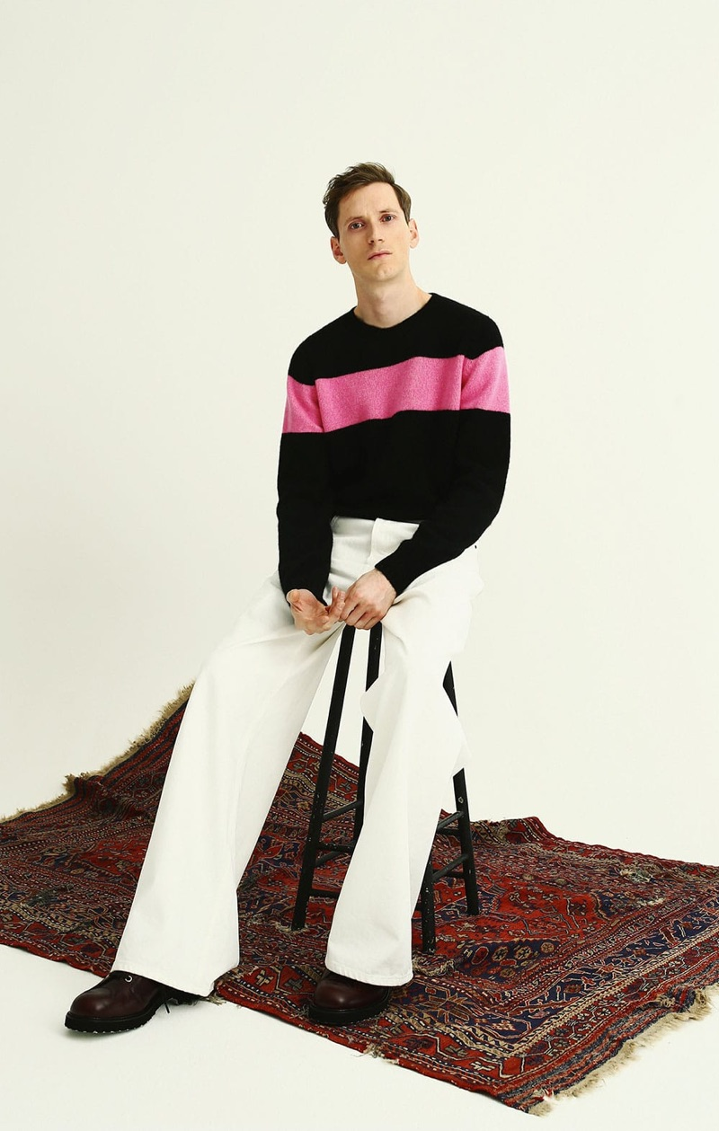 Matches Fashion enlists model Bastiaan Ninaber to sport a sweater by The Elder Statesman with Balenciaga jeans, and Loewe boots.