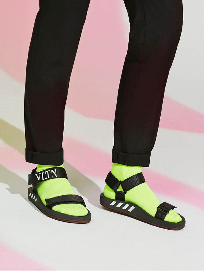 A fashion statement arrives in the form of Valentino logo sandals.