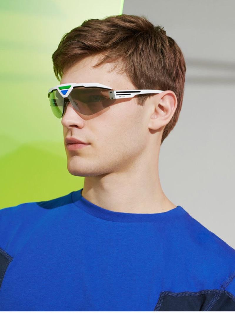 A futuristic vision, Bo Develius rocks Prada runway sunglasses.