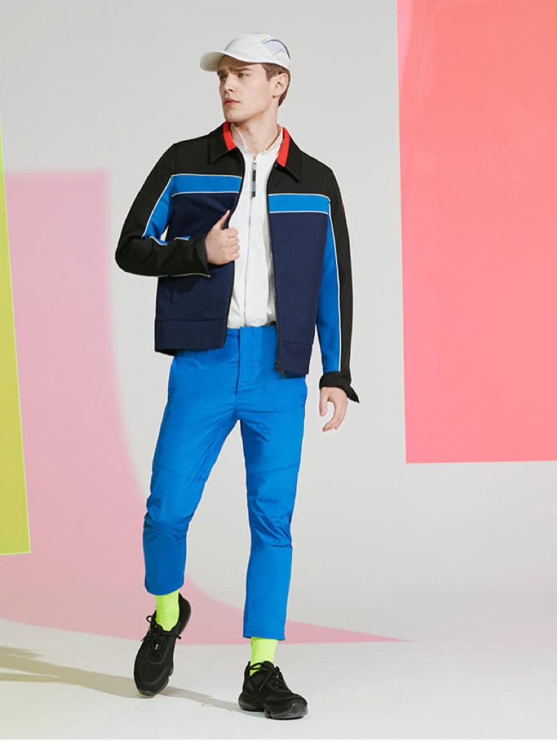 Embracing ultra-saturated colors, Bo Develius steps into a pair of Jil Sander pants.