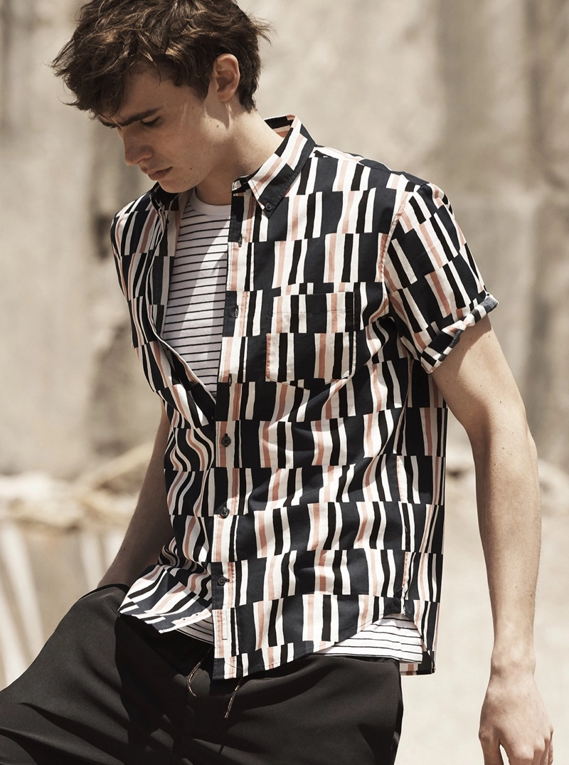 Mixing prints, Liam Little sports a striped tee with a Club Monaco graphic shirt $79.50.
