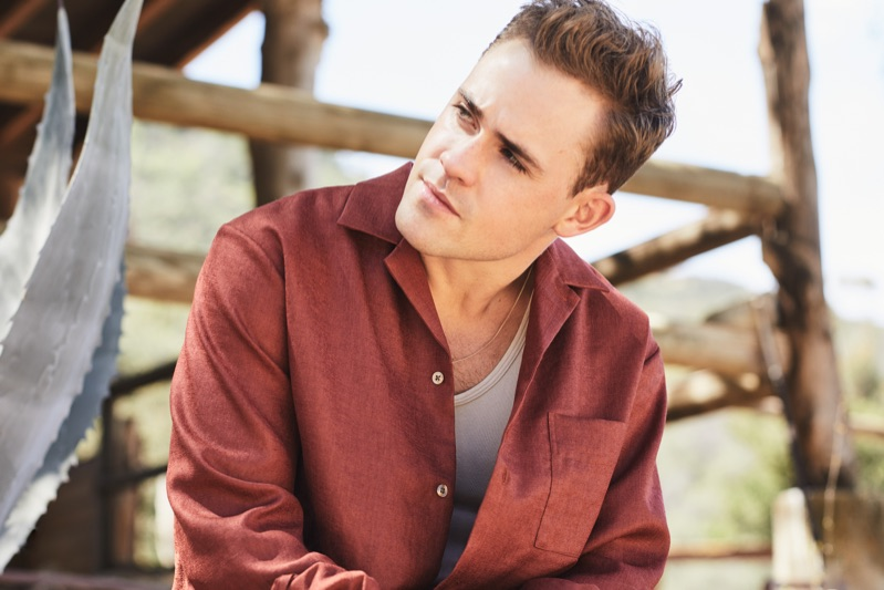 Actor Dacre Montgomery sports a Camoshita camp-collar shirt, Billy tank, and a Saint Laurent necklace.