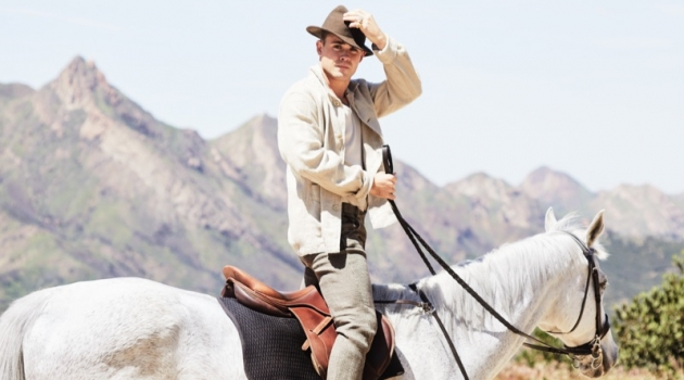Riding a horse, Dacre Montgomery sports an Our Legacy linen jacket, Billy tank, Man 1924 trousers, and Golden Goose sneakers.
