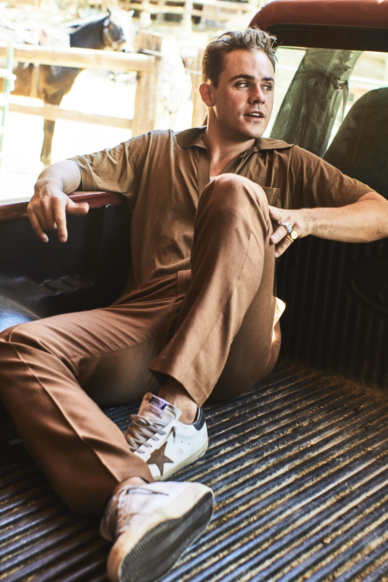 Embracing brown, Dacre Montgomery dons a Dries Van Noten polo, Billy tank, Camoshita trousers, and Golden Goose sneakers.