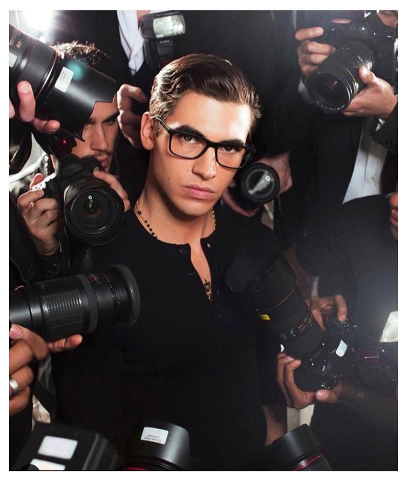 Donning black framed glasses, model Marco Bellotti stars in Dolce & Gabbana's latest eyewear campaign.