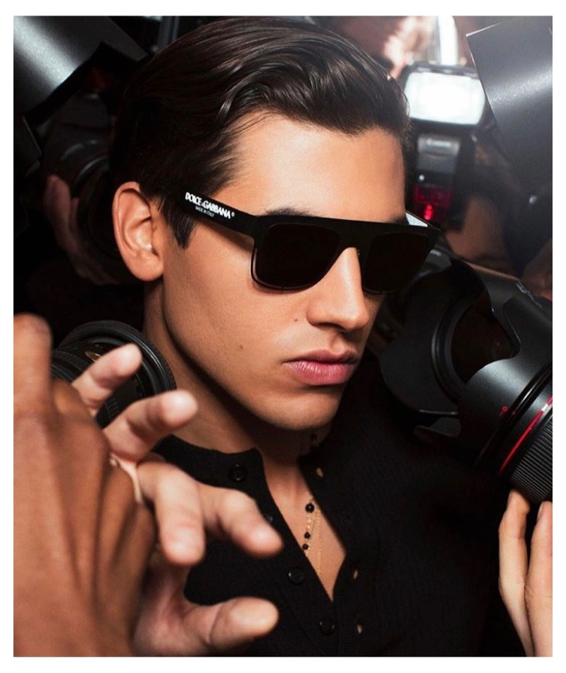Surrounded by photographers, model Marco Bellotti fronts Dolce & Gabbana's new eyewear campaign.