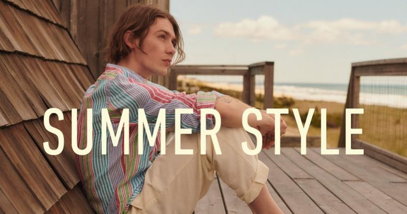 Luca Bertea wears a POLO Ralph Lauren striped linen shirt and Albam drawstring trousers.