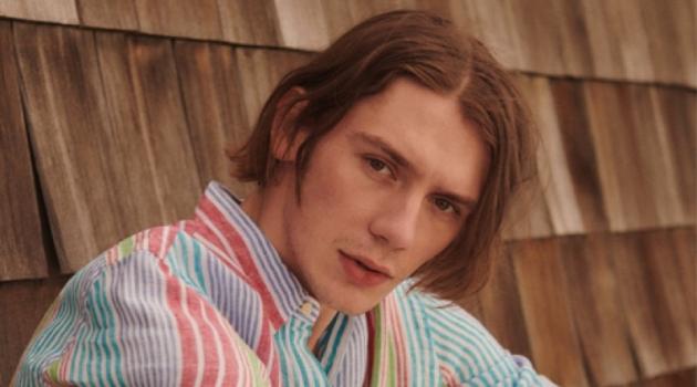 Reuniting with East Dane, Luca Bertea sports a POLO Ralph Lauren striped linen shirt and Albam drawstring trousers.