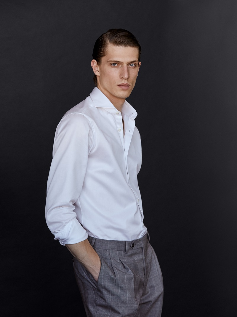 Sporting a clean shirt and trousers look, Edoardo Sebastianelli wears Massimo Dutti.