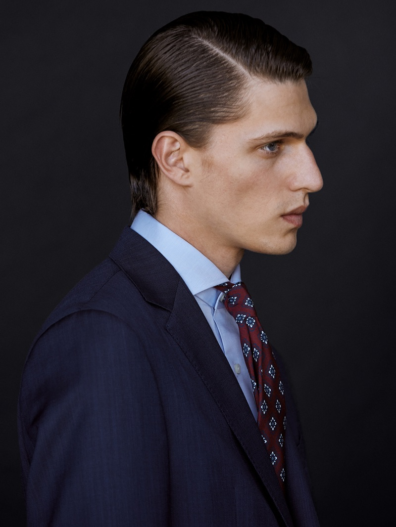 Delivering a side profile, Edoardo Sebastianelli models a look by Massimo Dutti.