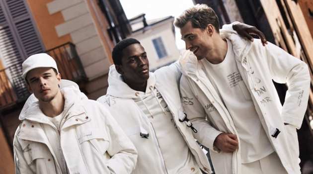 Clad in white, André Bona, Daniel Morel, and Ivan Kozak star in Emporio Armani's fall-winter 2019 men's campaign.