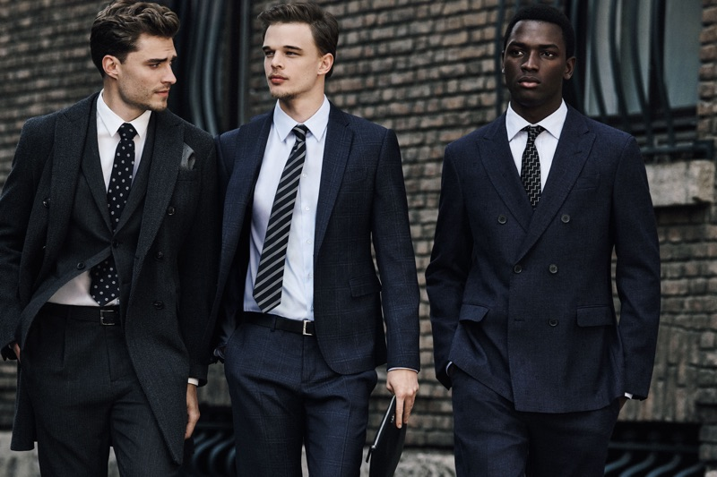 Donning tailored suits, Clad in white, Ivan Kozak, André Bona, and Daniel Morel appear in Emporio Armani's fall-winter 2019 men's campaign.