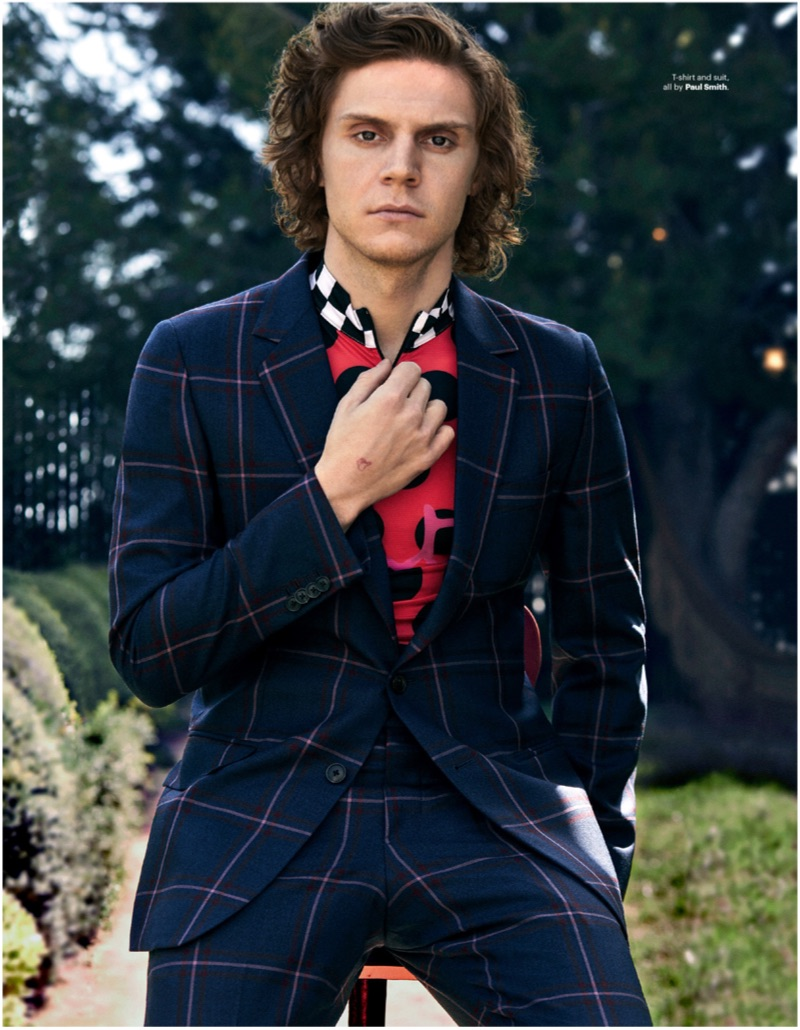 Donning a windowpane print suit, Evan Peters wears Paul Smith.