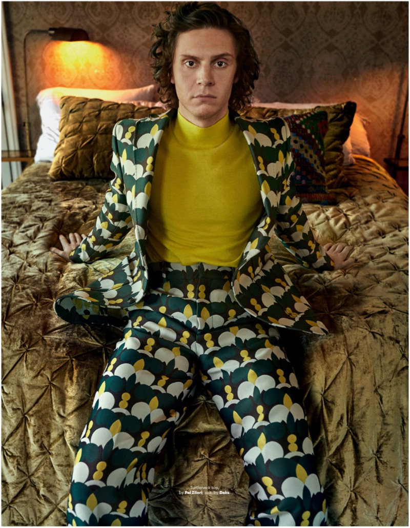 Embracing a quirky print, Evan Peters sports a Daks suit with a Pal Zileri turtleneck.