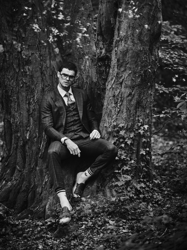 Embracing a dapper edge, Christian Williams wears all clothes Helen Anthony and glasses Delirious Eyewear.