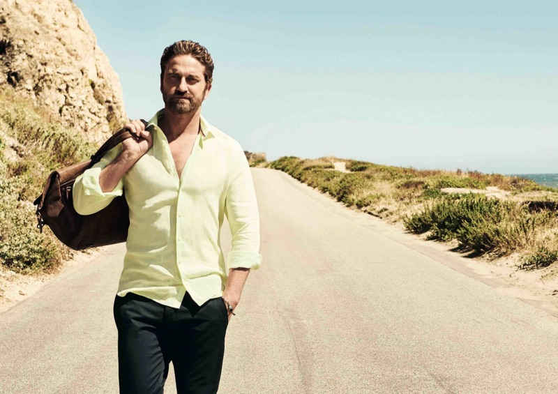 Embracing a pop of color, Gerard Butler wears a yellow shirt by OLYMP.