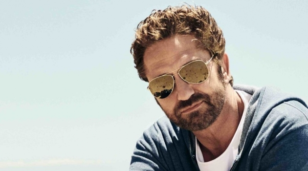 A cool vision, Gerard Butler rocks sunglasses and poses on a motorcycle for OLYMP.