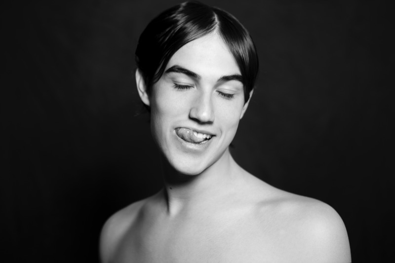 Nologo Mgmt model Gianmarco Lusiani sits for a cheeky photo.