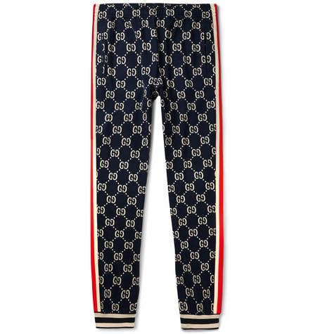 2dde4e858728b Gucci – Tapered Striped Logo-Intarsia Cotton Track Pants – Men – Navy