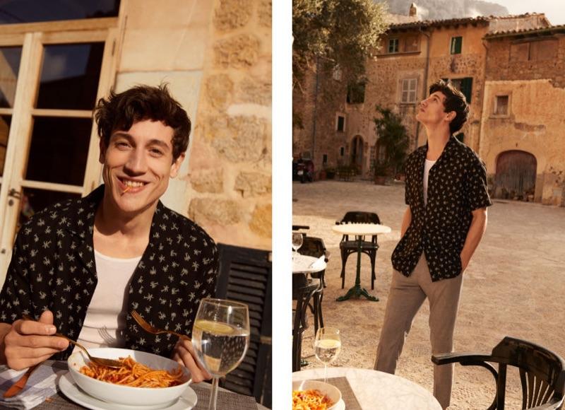 Enjoying a bowl of spaghetti, Nicolas Ripoll wears a black H&M palm trees resort shirt $12.99.