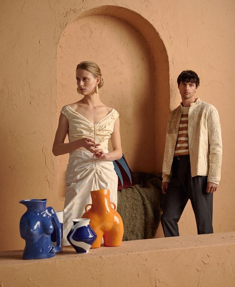 Posing right, Hannes Gobeyn rocks a By Walid jacket, Acne Studios sweater, and Officine Generale trousers.