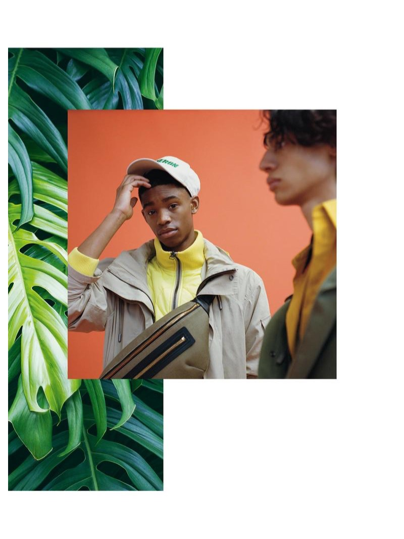 From left, Montell wears YVES SALOMON jacket and top £1,170 (sold together); HERON PRESTON cap from a selection; TOM FORD belt bag £990; Benjamin wears YVES SALOMON jacket £810; QASIMI shirt £285